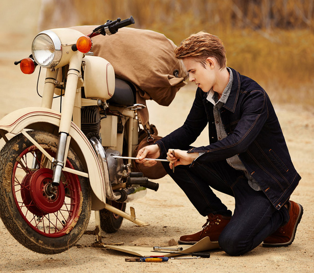 Jeans for Men Man repairing Motorcycle